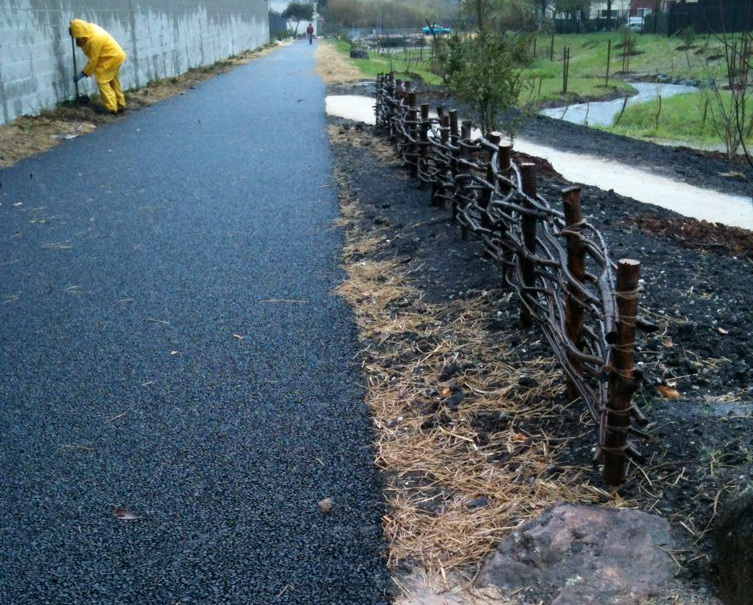 Bike trail along newly restored Codornices is permeable asphalt.