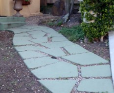 Walkway to front door with space between flat stones