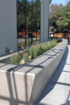 Raised flow-through planters edge much of Walnut Creek Library